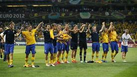Sweden's players celebrate at the end of their Group D Euro 2012 soccer match against France at the Olympic stadium in Kiev, June 19, 2012. REUTERS/Michael Dalder