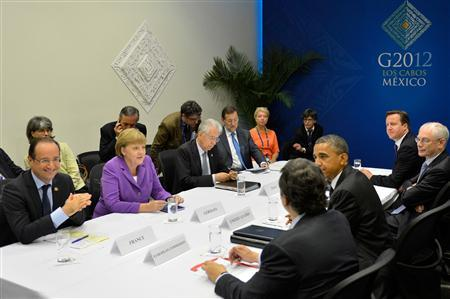 (L row front to back): French President Francois Hollande, German Chancellor Angela Merkel, Italy's Prime Minister Mario Monti, Spain's Prime Minister Mariano Rajoy, (R row back to front): Britain's Prime Minister David Cameron, European Council President Herman Van Rompuy, U.S. President Barack Obama and European Commission President Jose-Manuel Barroso meet on the second day of the G20 Summit in Los Cabos, June 19, 2012. REUTERS/Mexico Presidency/Handout