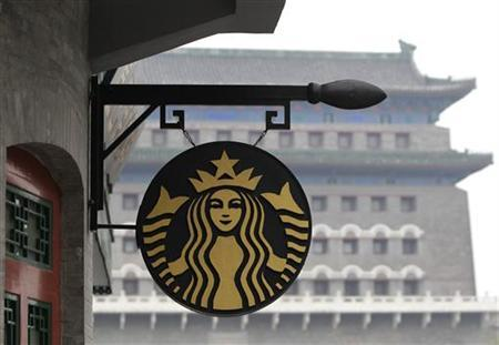 The Starbucks logo is seen outside its coffee store in front of Zhengyangmen Gate at Qianmen Commercial Street in central Beijing, April 19, 2012. REUTERS/Jason Lee