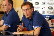 France's soccer coach Laurent Blanc reacts during a news conference in Donetsk during the Euro 2012 June 20, 2012. France lost to Sweden yesterday in their last match of Group D but qualified for the quarter-finals . REUTERS/Charles Platiau