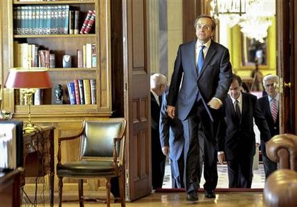Conservative New Democracy leader Antonis Samaras arrives at the Presidential Palace in Athens June 20, 2012. Samaras was later sworn in as Greece's new Prime Minister. REUTERS/Andreas Solaro/Pool