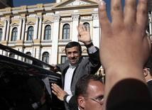 Iran's President Mahmoud Ahmadinejad waves to the crowd after leaving Bolivia's Presidential palace in La Paz, June 19, 2012. REUTERS/David Mercado