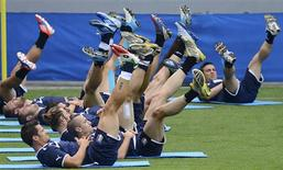 Italy's soccer players stretch during a training session during the Euro 2012 in Krakow June 20, 2012. REUTERS/Nigel Roddis