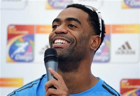 Sprinter Tyson Gay of the U.S. answers a question during a news conference for the IAAF World Championships in Daegu, August 25, 2011. REUTERS/Mark Blinch