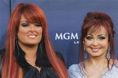 The Judds, Wynonna Judd (L) and Naomi Judd arrive at the 46th annual Academy of Country Music Awards in Las Vegas April 3, 2011. REUTERS/Sam Morris