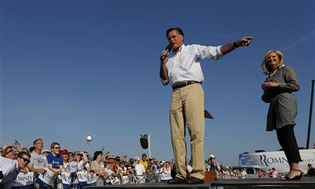 U.S. Republican presidential candidate Mitt Romney and his wife Ann, address a crowd during a campaign event at Holland State Park in Michigan June 19, 2012. REUTERS/Larry Downing