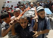 Palestinian carry the body of a militant Ghalib Rmelat during his funeral in Rafah in the southern Gaza Strip June 20, 2012. REUTERS/Ibraheem Abu Mustafa