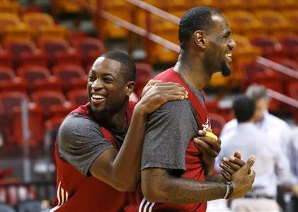 Miami Heat players Dwyane Wade (L) and LeBron James (R) joke around during a team practice at the NBA basketball finals in Miami June 20, 2012. REUTERS/Mike Segar