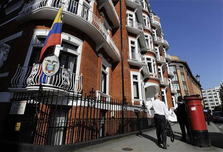 A man walks past Ecuador's embassy in London June 20, 2012. WikiLeaks' founder Julian Assange has taken refuge in Ecuador's embassy in London and asked for asylum, officials said on Tuesday, in a last-ditch bid to avoid extradition to Sweden over sex crime accusations. REUTERS/Paul Hackett