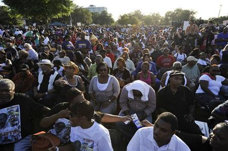 An estimated eight-thousand people showed up for a public rally to honor the memory of Trayvon Martin, at Fort Mellon Park in Sanford, Florida March 22, 2012. REUTERS/Octavian Cantilli