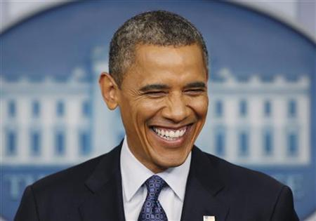 U.S. President Barack Obama smiles while answering questions in the White House Press Briefing Room in Washington, June 8, 2012. REUTERS/Larry Downing