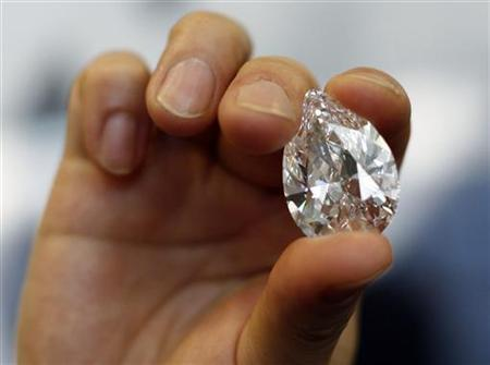 A Pear-shaped D-colour flawless 72.22 carat diamond is shown during a press preview at Sotheby's Auction House in New York, March 11, 2008. REUTERS/Shannon Stapleton
