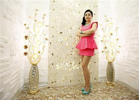 North Korean defector living in South Korea, Han Seo-hee, 30, poses during an interview with Reuters at a studio of a South Korean television talk show in Goyang, north of Seoul June 14, 2012. REUTERS/Lee Jae-Won