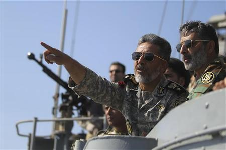 Iran's Navy commander Habibollah Sayyari (C) points while standing on a naval ship during Velayat-90 war game on Sea of Oman near the Strait of Hormuz in southern Iran January 1, 2012. REUTERS/Fars News/Hamed Jafarnejad