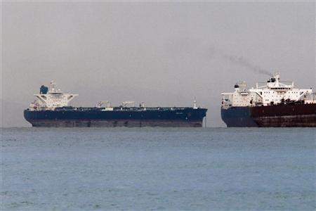 Vessels sail past Malta-flagged Iranian crude oil supertanker ''Delvar'' (L) anchoring off Singapore March 1, 2012. REUTERS/Tim Chong