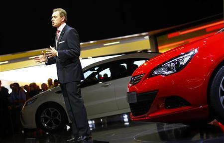 Karl-Friedrich Stracke, CEO of Adam Opel AG presents the new 'Astra GTC' car at the International Motor Show (IAA) in Frankfurt, September 13, 2011. REUTERS/Kai Pfaffenbach