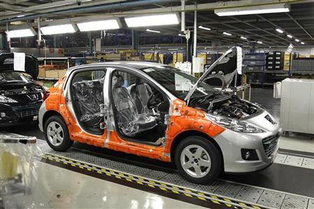 A Peugeot 207 is seen on the assembly line at the PSA Peugeot Citroen plant in Poissy, near Paris, January 27, 2012. REUTERS/Benoit Tessier