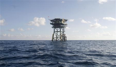 A Vietnamese floating guard station is seen on Truong Sa islands or Spratly islands in this April 12, 2010 file photo. China on June 21, 2012 ''vehemently opposed'' a Vietnamese law asserting sovereignty over islands in disputed waters, the latest escalation in tensions over the resource-rich South China Sea. Chinese Vice Foreign Minister Zhang Zhijun summoned Ambassador Nguyen Van Tho and told him that Hanoi's new law claiming the contested Paracel and Spratly Islands was a ''serious violation'' and called for an ''immediate correction''. REUTERS/Stringer/Files