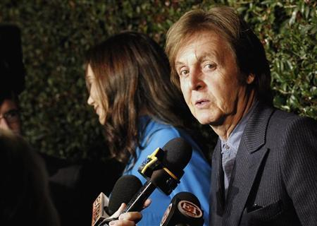 Music recording artist Paul McCartney is interviewed as he arrives for the world premiere of the video ''My Valentine'' directed by Paul McCartney in West Hollywood, California April 13, 2012. REUTERS/Mario Anzuoni