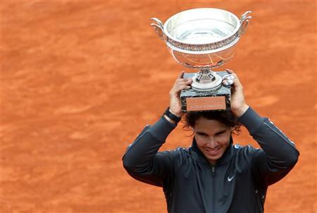 Rafael Nadal of Spain holds the trophy as he poses during the ceremony after defeating Novak Djokovic of Serbia during their men's singles final match at the French Open tennis tournament at the Roland Garros stadium in Paris June 11, 2012. REUTERS/Francois Lenoir