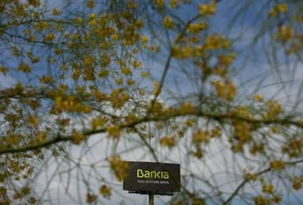 A billboard of Spain's lender bank Bankia is seen on the outskirts of Seville June 21, 2012. Spain's borrowing costs hit a new euro era high at a debt auction on Thursday, a few hours before it is expected to shed light on the dire state of its weaker banks and possibly make a formal request for European Union funds to rescue them. REUTERS/Marcelo del Pozo
