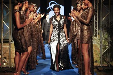 Designer And Organizer Of Dakar Fashion Week Adama Paris Ndiaye Joins Models Wearing Her