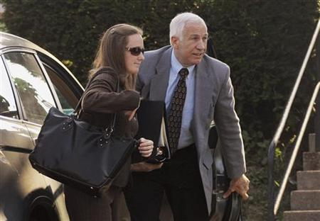 Former Penn State assistant football coach Jerry Sandusky (R) arrives at the Centre County Courthouse for the eighth day of his child sex abuse trial in Bellefonte, Pennsylvania June 21, 2012. REUTERS/Pat Little