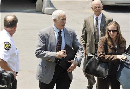 Former Penn State assistant football coach Jerry Sandusky (2nd L) leaves the Centre County Courthouse after closing arguments in his child sex abuse trial in Bellefonte, Pennsylvania June 21, 2012. REUTERS/Pat Little