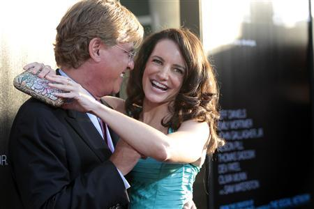 Creator and executive producer Aaron Sorkin and actress Kristin Davis pose at the premiere of the HBO television series ''The Newsroom'' at the Cinerama Dome in Los Angeles, California June 20, 2012. REUTERS/Mario Anzuoni