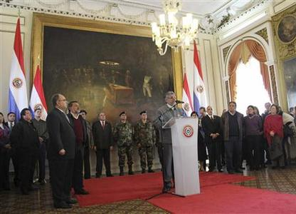 Paraguay's President Fernando Lugo (C) addresses a nationwide message at the Presidential Palace in Asuncion June 21, 2012. REUTERS/Lucas Nunez