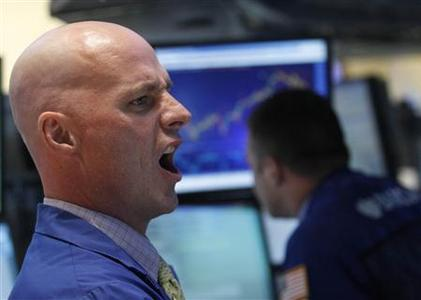 A specialist trader gives out a price on the floor of the New York Stock Exchange June 21, 2012. REUTERS/Brendan McDermid