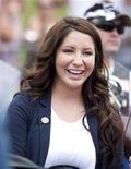 Bristol Palin, daughter of Sarah Palin, former governor of Alaska, smiles before taking part in the Rolling Thunder motorcycle ride to honour U.S. veterans in Washington May 29, 2011. REUTERS/Joshua Roberts