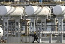 A worker walks in the Rosneft Achinsk oil refinery, one of the biggest Siberian fuel suppliers, near the town of Achinsk, some 188 km (117 miles) west of Krasnoyarsk, September 9, 2011. REUTERS/Ilya Naymushin