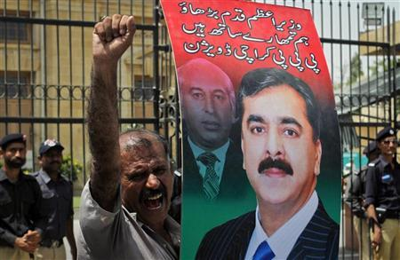 A supporter of the ruling Pakistan Peoples Party (PPP) holds an image of the Pakistan's Prime Minister Yusuf Raza Gilani as he shouts slogans during a protest against a Supreme Court verdict in Karachi April 26, 2012. REUTERS/Athar Hussain