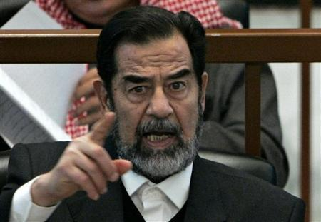 Deceased Iraqi President Saddam Hussein reacts in court during the Anfal genocide trial in Baghdad in this December 21, 2006 file photo. REUTERS/Nikola Solic
