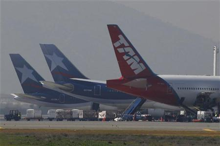 TAM Linhas Aereas and LAN airlines aircraft are parked at Santiago's international airport August 14, 2010. REUTERS/Ivan Alvarado