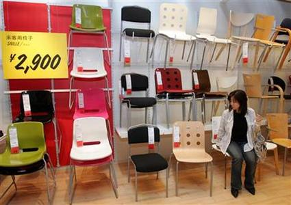 A Japanese woman takes a seat on one of Swedish furniture retailer IKEA's chairs at the company's first store in Japan in Funabashi, east of Tokyo, April 24, 2006. REUTERS/Yuriko Nakao/Files
