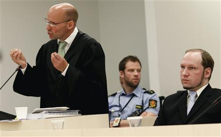 Defense lawyer Geir Lipepstad (L) gives his final statement in court during the trial of Anders Behring Breivik in Oslo, June 22, 2012. REUTERS/Heiko Junge/NTB Scanpix/Pool