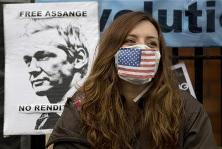 A supporter of WikiLeaks founder Julian Assange sits outside Equador's Embassy in London June 22, 2012. REUTERS/Neil Hall