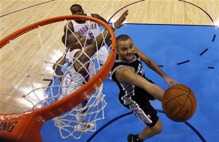 San Antonio Spurs' Tony Parker (R) goes to the basket in the fourth quarter as Oklahoma City Thunder's Russell Westbrook (L) and Kendrick Perkins (above) trail during Game 6 of the NBA Western Conference basketball finals in Oklahoma City, Oklahoma, June 6, 2012. REUTERS/Jim Young