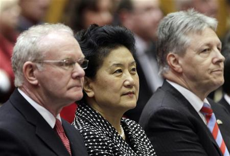 Chinese State Councilor Liu Yandong (C) sits beside Deputy First Minister Martin McGuinness (L) and First Minister Peter Robinson (R) at the University of Ulster near Belfast on the first leg of her European tour to Britain, Belgium and Cyprus. April 13, 2012. REUTERS/Cathal McNaughton
