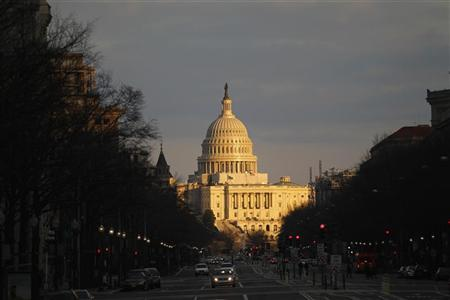 A view of the U.S. Capitol building during sunset from Pennsylvania Avenue in Washington February 5, 2012. REUTERS/Jose Luis Magana