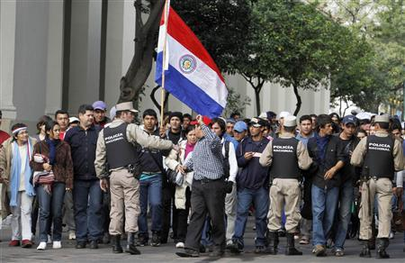 Supporters of Paraguayan President Fernando Lugo wait outside the Congress building, before Lugo's impeachment in Asuncion June 22, 2012. REUTERS/Jorge Adorno