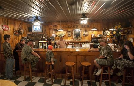 Owner Rex Pritchett talks to hunters before setting off on a wild hog hunt at Great Southern Outdoors Wildlife Plantation in Union Springs, Alabama, June 15, 2012. REUTERS/Michael Spooneybarger