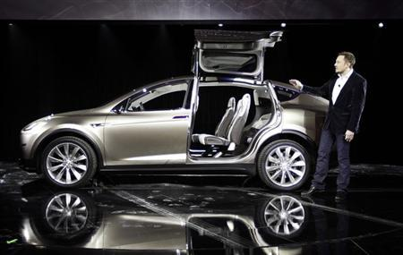 Tesla CEO and co-founder Elon Musk unveils the Tesla Motors Model X electric vehicle at the Tesla Design Studio in Hawthorne, California February 9, 2012. REUTERS/David McNew