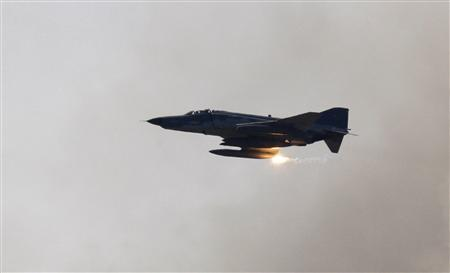 A Turkish Air Force F-4 war plane fires during a military exercise in Izmir, in this May 26, 2010 file photo. REUTERS/ Osman Orsal/Files