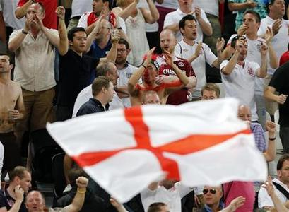 England soccer fans cheer before their Group D Euro 2012 soccer match against Ukraine at the Donbass Arena in Donetsk, June 19, 2012. REUTERS/Yves Herman