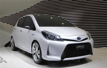 A new Toyota Yaris HSD Concept hybrid car is displayed during the first media day of the 81st Geneva Car Show at the Palexpo in Geneva March 1, 2011. REUTERS/Denis Balibouse