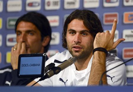 Italy's soccer player Salvatore Sirigu (R) gestures during a Euro 2012 news conference in Krakow June 22, 2012. REUTERS/Nigel Roddis