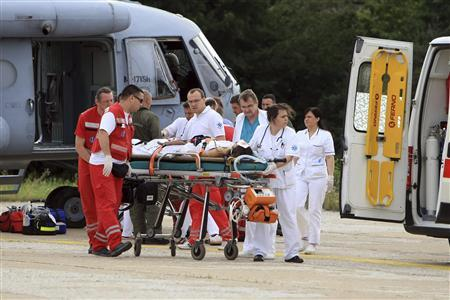Medical personnel push an injured bus crash passenger who was transferred by a helicopter to the KBC Dubrava hospital in Zagreb June 23, 2012. REUTERS/Pixsell/Handout